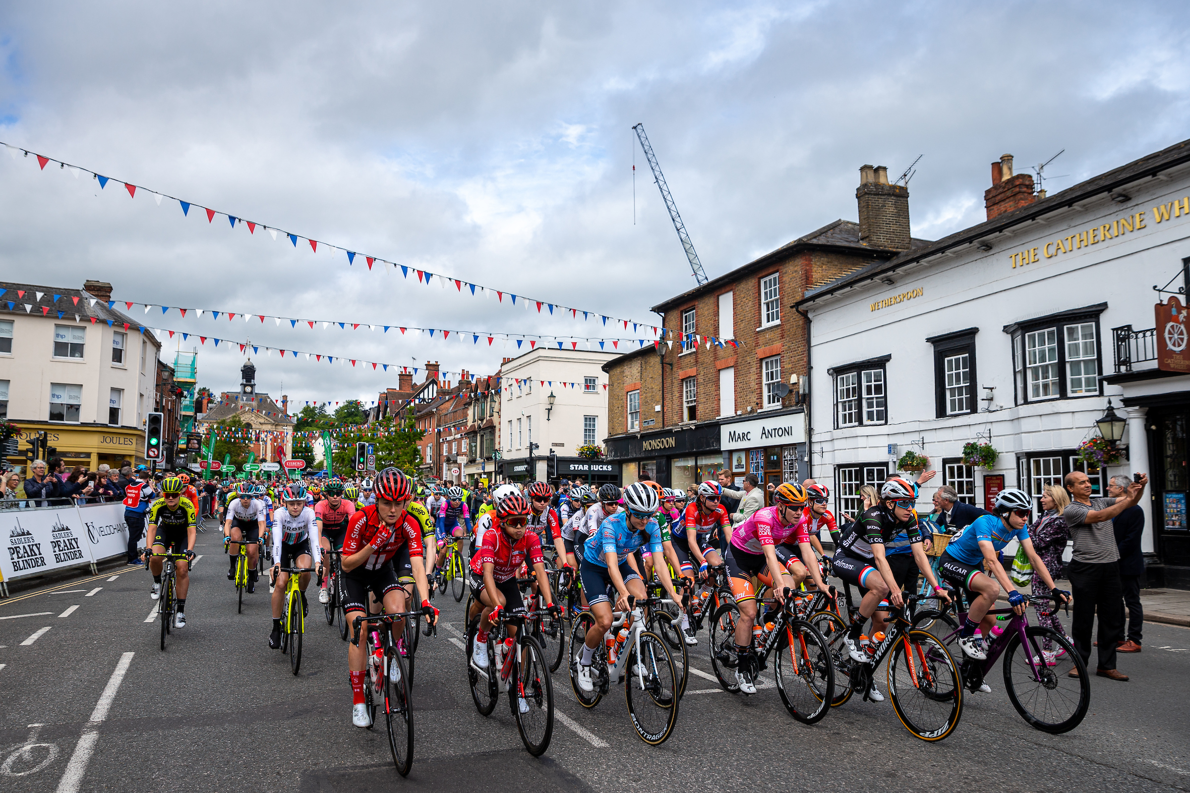 Race competitors cycle through Henley-on-Thames